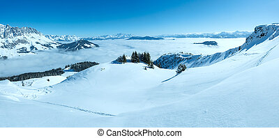 Morning winter mountain landscape with clouds in below...