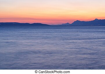 Adriatic sea at sunset in Podgora, Croatia. Long exposure.