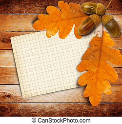 Old grunge paper with autumn oak leaves and acorns on the...