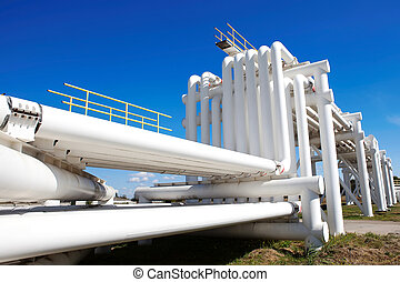 Industrial pipe with gas and oil and water on a background...