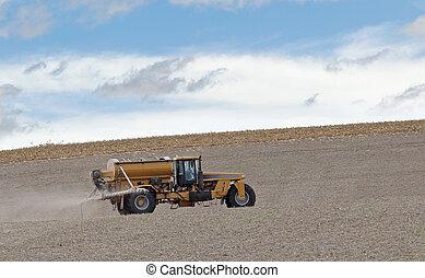 Spraying Farm Field - Spraying fertilizer onto a recently...