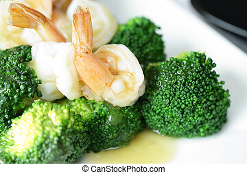 Gravy and Shrimp with broccoli on white dish