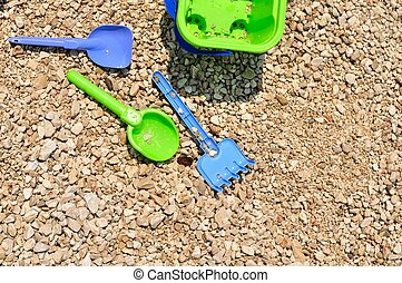 Bucket, spade and shovel on beach - Beach toys - bucket,...