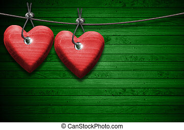 Red Wooden Hearts on Green Wood Background - Two handmade...