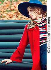 fashion model outdoor portrait - womanin red coat fashion...