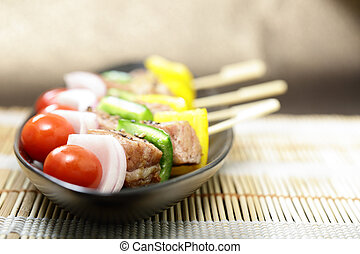 barbecue Skewers colorful kabobs on back dish