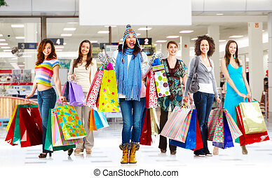 Woman with shopping bags - Young women group with shopping...