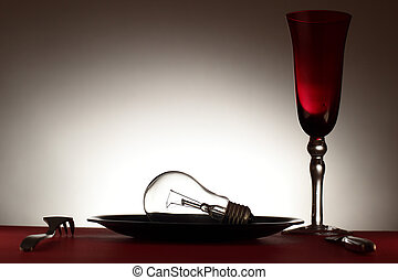 Bulb in plate,cutlery and wineglass - Light bulb in plate,...