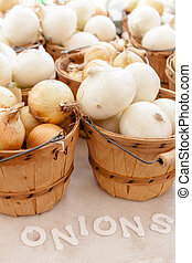 Farmers Market - Home grown organic white onions in brown...