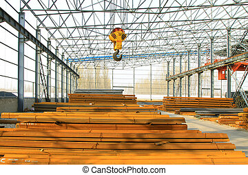 Steel structure workshop and raw materials, in a factory,...