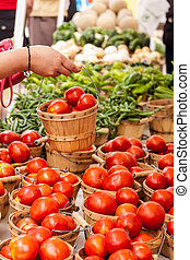Farmers Market - Female hand handling bushel basket of fresh...