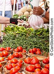 Farmers Market - Customer paying for fresh organic...