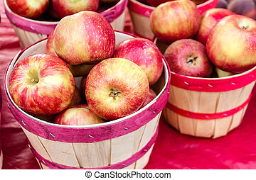 Farmers Market - Organic red apples in colorful bushel...