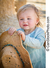 Adorable Baby Girl with Cowboy Hat at the Pumpkin Patch -...