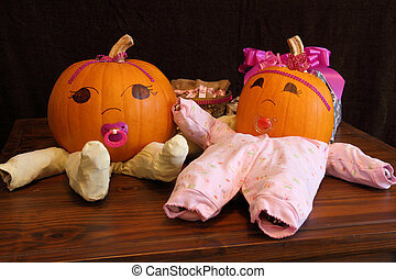 Pumpkin Babies in Onesies Wide Angle - Two pumpkins dressed...