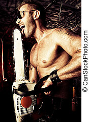 chainsaw - Expressive handsome muscular man with a chainsaw...