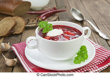 Borsh Russian traditional dish in a bowl on the table