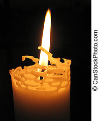 Candlelight against a black background