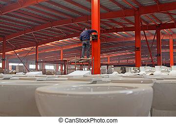 worker welding metal parts
