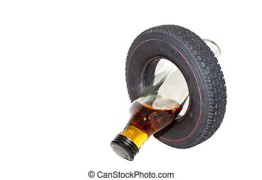 Vertical Crossed Over Vehicle Tyre and Alcohol Bottle -...