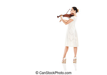 Beautiful young woman playing violin over white
