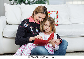 Mother And Daughter With Letter - Mother and daughter with...
