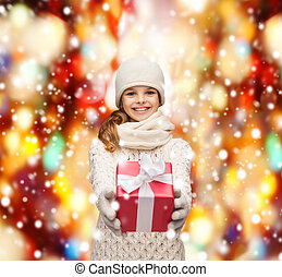 girl in hat, muffler and gloves with gift box - christmas,...
