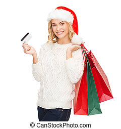 woman with shopping bags and credit card - shopping, sale,...