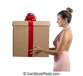 Christmas present - Fashion girl holds a big Christmas...