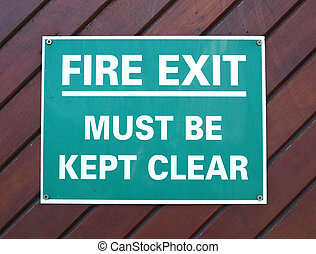 fire exit - Fire exit sign with white text over green