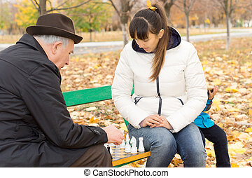 Elderly man playing a game of chess