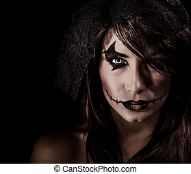Terrifying witch portrait isolated on black background,...