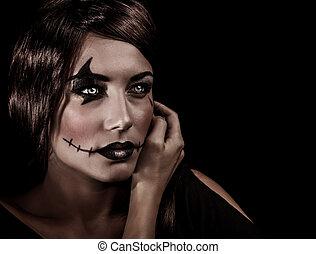 Aggresive Halloween makeup - Closeup portrait of beautiful...