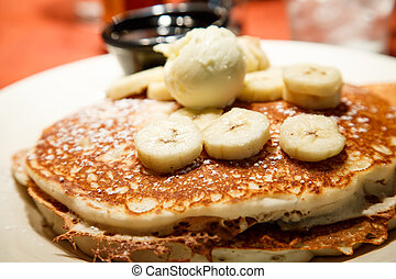 Fresh Banana Pancakes with Butter and Syrup