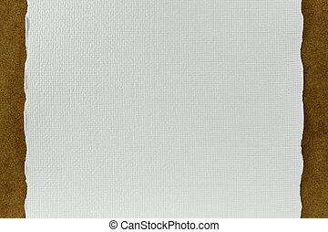 white handmade paper on cork board