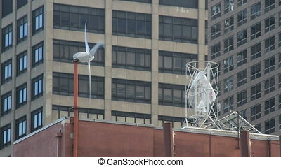 Rooftop Energy (2 Shots) - Wind energy at work atop a city...