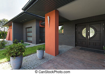 Entrance to a huge house- wooden door