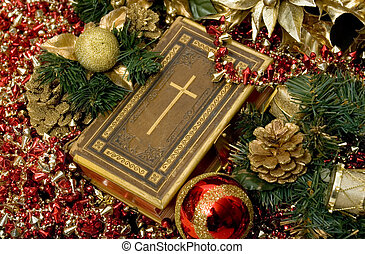 Christian Christmas - Selective focus on Bible surrounded by...