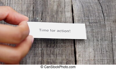 Time for action - A Time for action paper sign on wood...