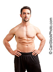 Fit Man Standing With Arms At His Waist