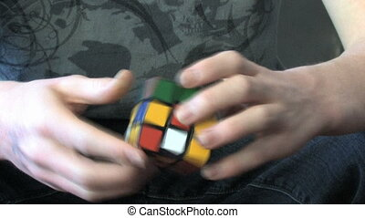 Rubiks Cube Genius - Hands of a master solving a rubiks cube...