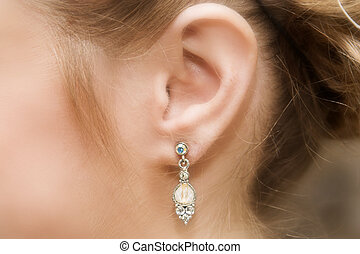 Jewelery - Close up of a brides ear with a pearl and diamond...
