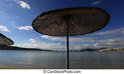 Bodrum Bay - time lapse umbrella on the beach at very famous...