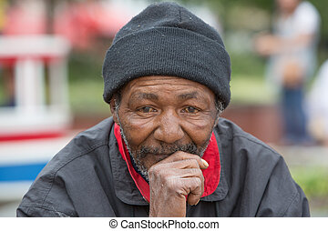Homeless Man Thinking - Portrait of homeless man thinking...
