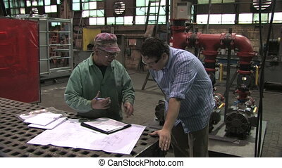Signing Document in Factory - A factory worker and...