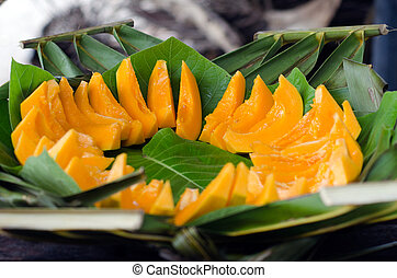 Papaya Tropical Fruit - Slices of Papaya fruit on a leaf...