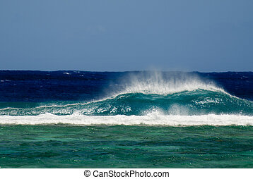 Big wave break into a reef of a lagoon of Pacific Island -...