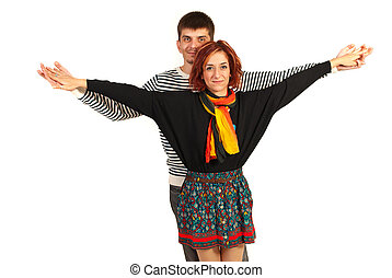 Happy couple with hands stretched