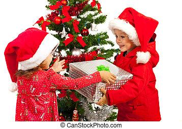 Boy giving Christmas present to girl