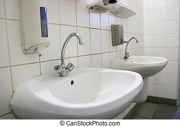 Taps and wash basins of a restroom